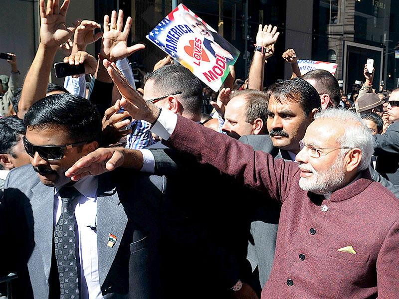 Narendra Modi is greeted by dignitaries as he arrives at John F. Kennedy Airport. (Reuters Photo)