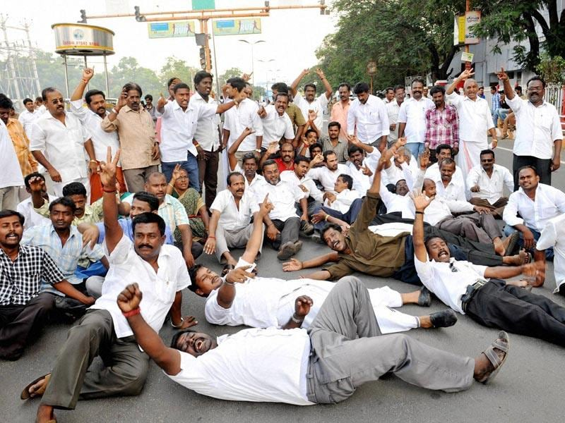 Members of AIADMK holding a protest in Coimbatore over conviction of the party supremo Jayalalithaa by a Bangalore court in a disproportionate assests case. (PTI Photo)