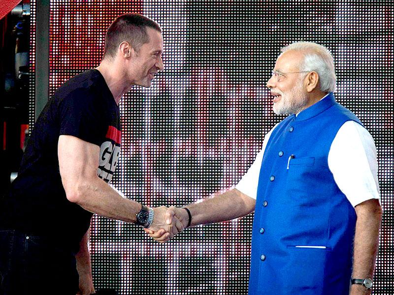 Prime Minster Narendra Modi shakes hands with actor Hugh Jackman on stage during the Global Citizen Festival concert in Central Park in New York. (Reuters)