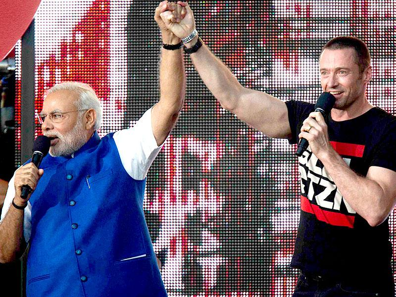 Prime Minster Narendra Modi holds hands with actor Hugh Jackman on stage during the Global Citizen Festival concert in Central Park in New York. (Reuters)