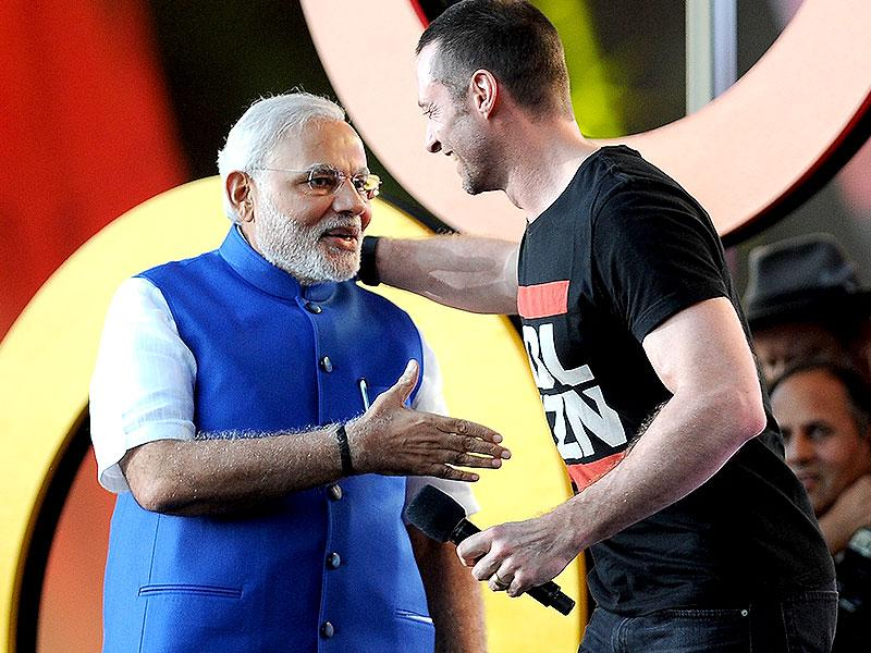 Prime Minister of India Narendra Modi, left and Hugh Jackman speak at the 3rd Global Citizen Festival at Central Park in New York. (AP photo)