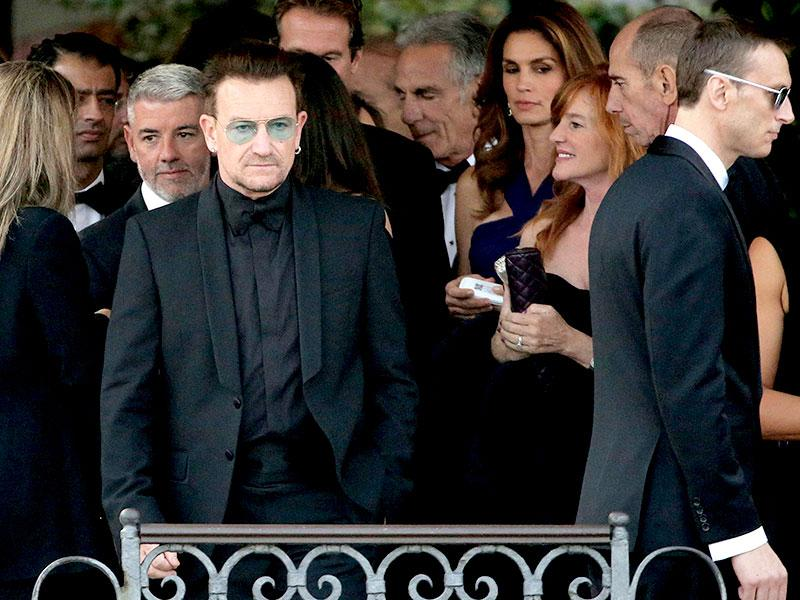 Irish singer Bono, lead vocalist of band U2, arrives to board a taxi boat transporting guests to the venue of a gala dinner ahead of the official wedding ceremony of George Clooney and his fiancee Amal Alamuddin in Venice. (Reuters)