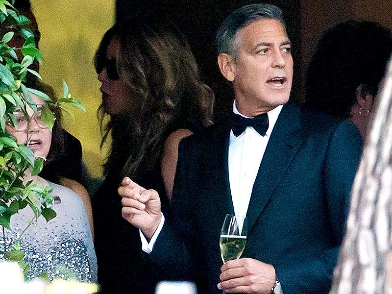 Actor George Clooney attends a cocktail with guests at the Cipriani hotel ahead of his wedding with Amal Alamuddin in Venice. (AP)