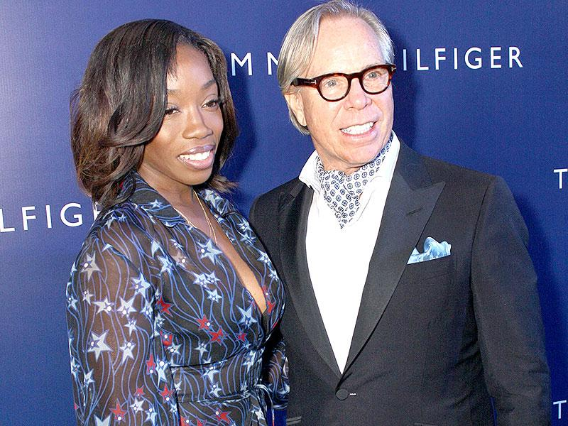 Grammy award winner singer-songwriter Estelle who performed in India for the first time to mark American fashion brand Tommy Hilfiger's 10th anniversary in the country poses with the designer. (IANS)