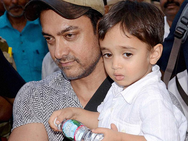 Aamir Khan, with his son Azad Rao Khan, arrives in Bhopal. (PTI Photo)