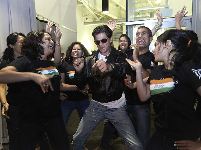 Shah Rukh does a step or two with the Google girls.