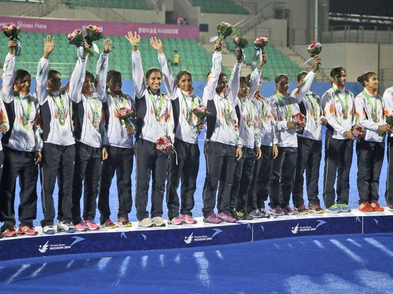 India's team celebrate with their bronze medal during the victory ceremony for the women's hockey at the 17th Asian Games in Incheon. (AP Photo/Dita Alangkara)