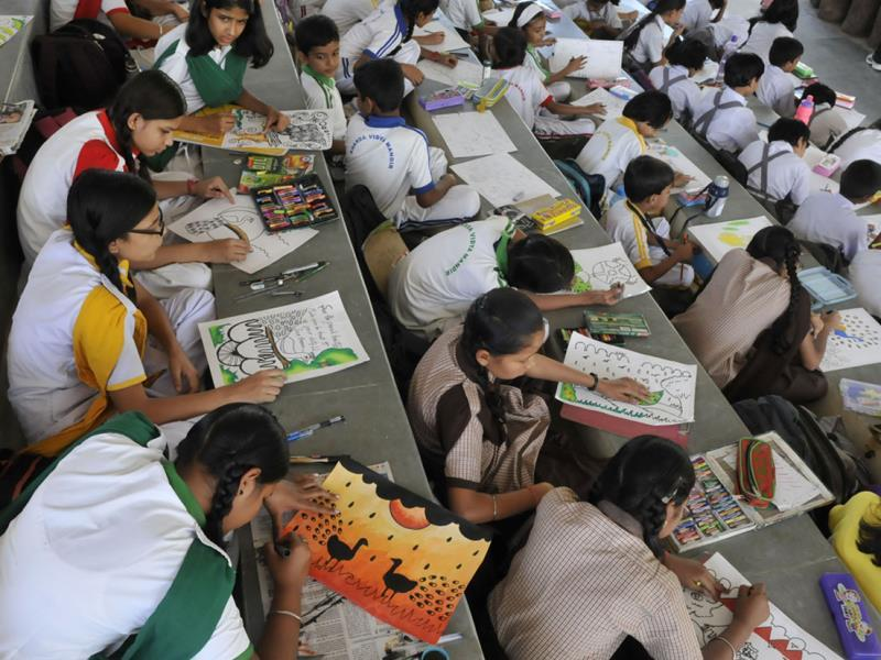 Children take part in a painting competition organised on the first day of Wildlife Week at Van Vihar National Park, in Bhopal on Wednesday. (Mujeeb Faruqui/HT photo)