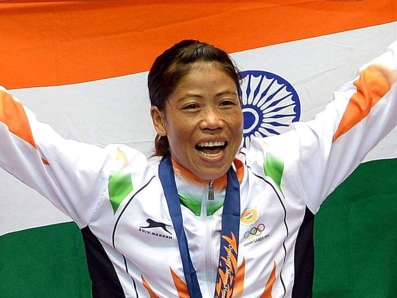 Gold medallist India's Hmangte Chungneijang Mary Kom celebrates during the victory ceremony after winning the women's flyweight boxing final match against Kazakhstan's Shekerbekova Zhaina during the 2014 Asian Games at the Seonhak Gymnasium in Incheon. (AFP Photo)