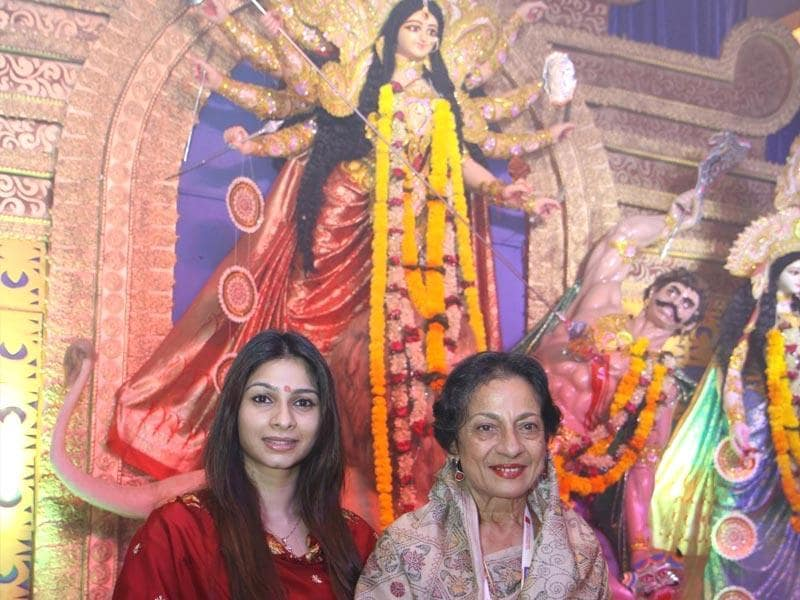 Veteran actor Tanuja and Tanishaa Mukerji pose for the shutterbugs during the Durga pooja celebration in Mumbai. (Photo: IANS)