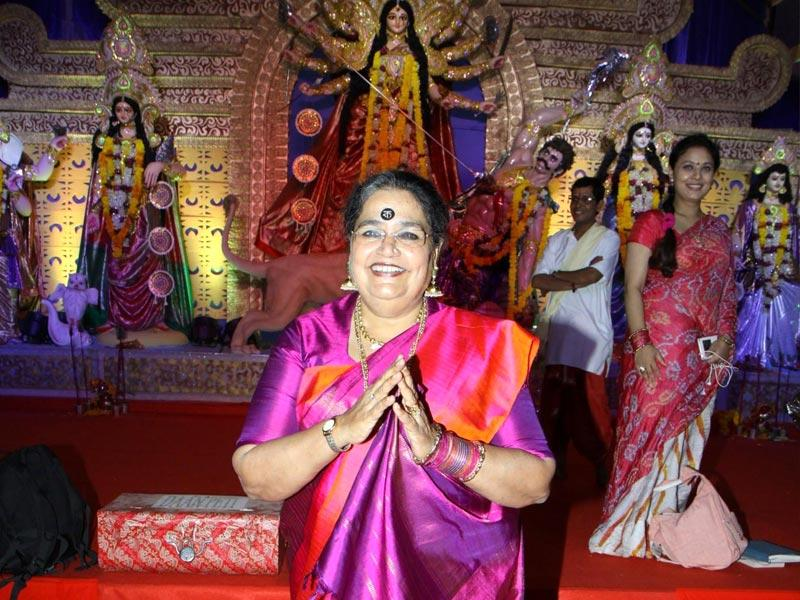 Singer Usha Uthup greets all during the Durga pooja celebration in Mumbai . (Photo: IANS)