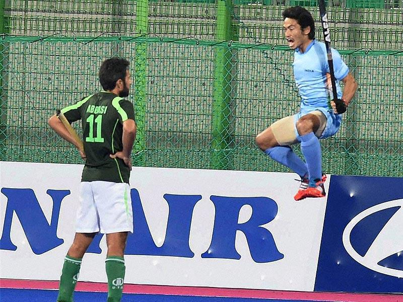 India's Khadangbam Kothajit Singh exults after scoring a goal against Pakistan in the final match of men's hockey on Thursday. (PTI Photo)