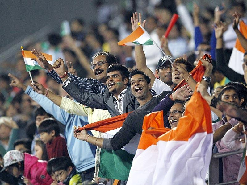 India fans celebrate after their team wins the men's gold medal hockey match against Pakistan at the 17th Asian Games on Thursday. (AP Photo)