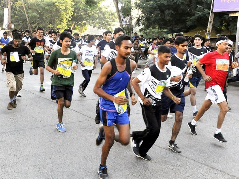 Students of IIM-Indore participate in a marathon from Dussehra maidan to IIM campus, Rau on the occasion of Gandhi Jayanti. (Arun Mondhe/Hindustan Times)