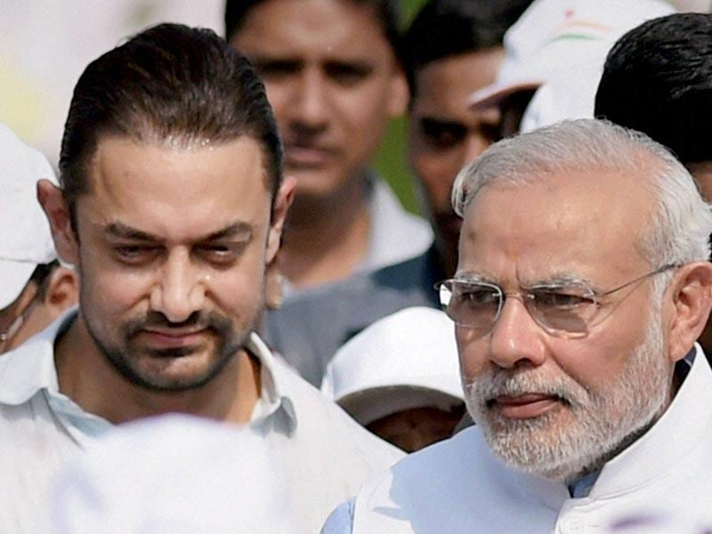 Prime Minister Narendra Modi with actor Aamir Khan at a walkathon after the launch of the nationwide cleanliness campaign Swachh Bharat Mission in New Delhi. (Photo: PTI)