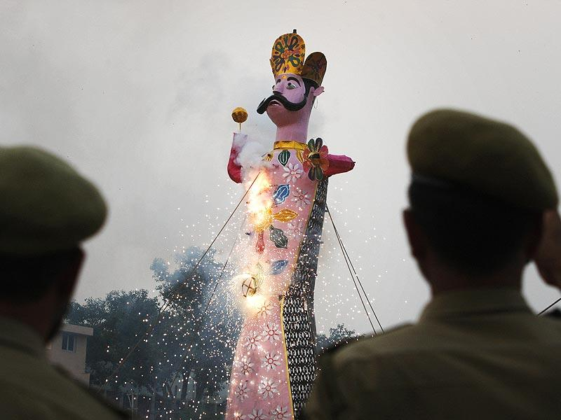 Policemen watch an effigy of Ravana's son Meghnath go up in flames marking the end of Dussehra festival in Jammu. (AP Photo)