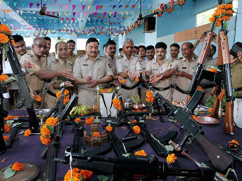 Police personnel worship their weapons on the occasion of Dusshera in Thane. (PTI Photo)