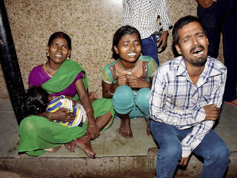 Family of injured victims weep outside a hospital where the stampede victims were admitted. PTI Photo