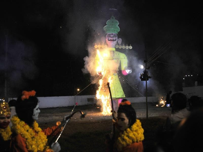An effigy of Ravana being burnt at TT Nagar Dussehra Ground in Bhopal on Friday. (Praveen Bajpai/HT photo)