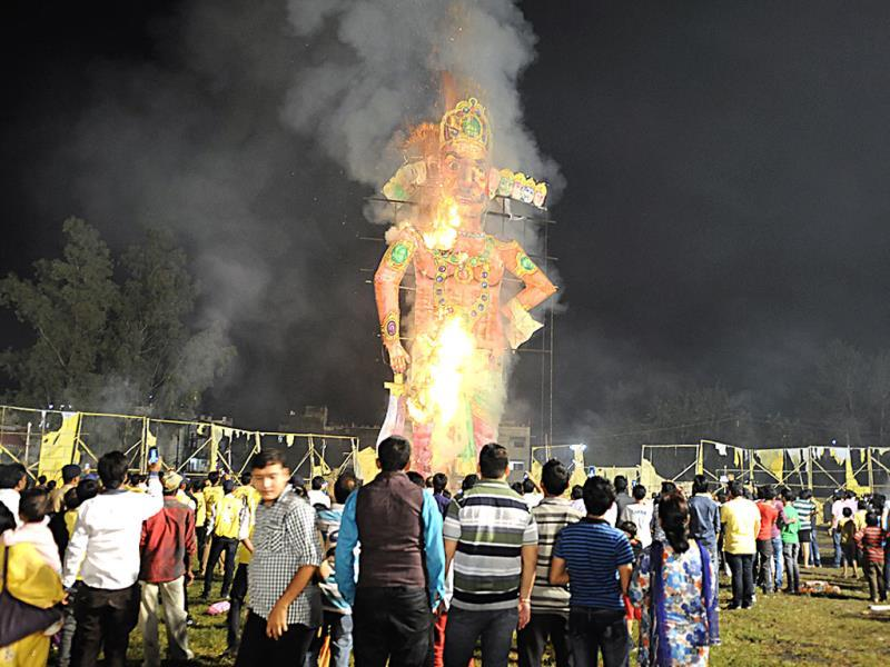 An effigy of Ravana being burnt at Dussehra Maidan in Indore on Friday. (Arun Mondhe/HT photo)