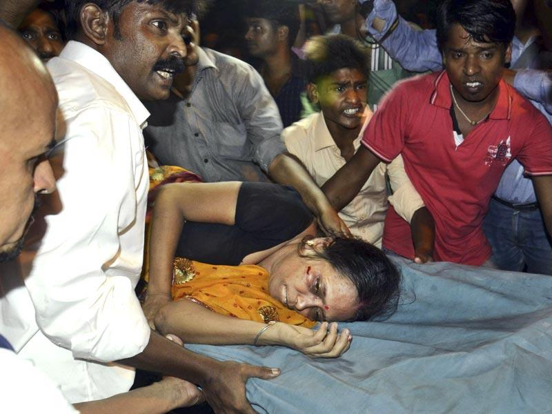 An injured woman is carried on a stretcher to a hospital for treatment in Patna on Friday. AP
