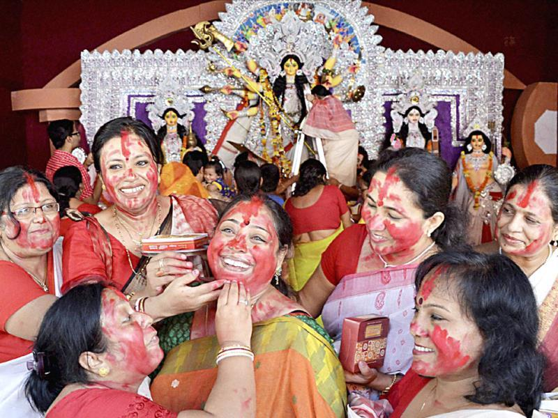 Bengali women take part in 'Sindur Khela' on the last day of Durga Puja at Kalibari, in Bhopal on Saturday. (PTI photo)