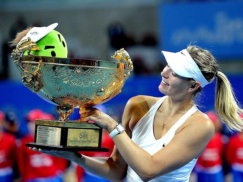 Maria Sharapova of Russia poses with her trophy after beating Petra Kvitova of the Czech Republic in the women's singles final match at China Open. (AFP Photo/Goh Chai Hin)