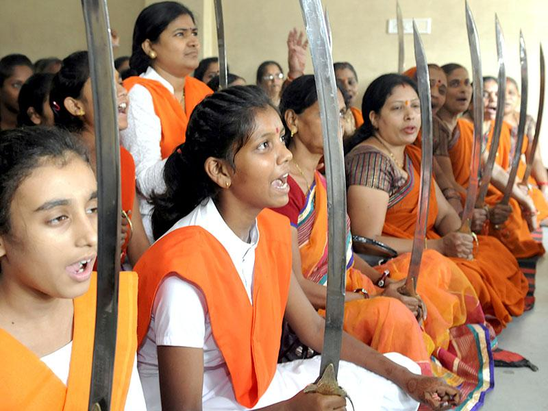 Young girls brandish swords as they take resolve to defend country, religion on occasion of shastra puja organised by Durga Vahini, a VHP outfit in Indore, India. (Amit K Jaiswal/HT Photo)