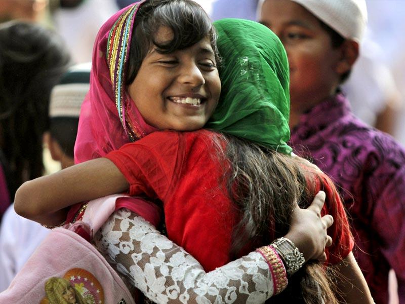 Muslim devotees hug each other after offering prayers on Eid al-Adha in Kolkata. (AP photo)