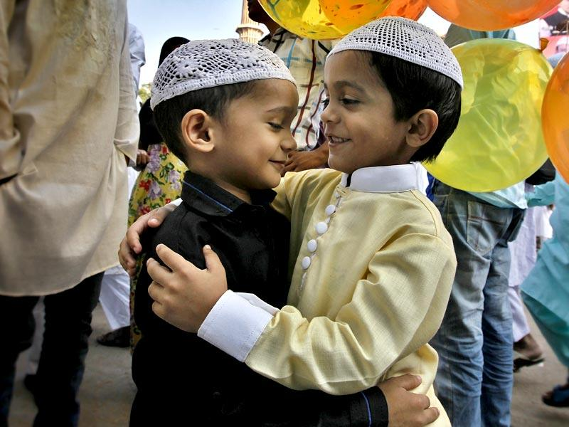 Muslims greet each other after offering Eid al-Adha prayers at the Jama Masjid in New Delhi. (photo by Raj K Raj/ HT)