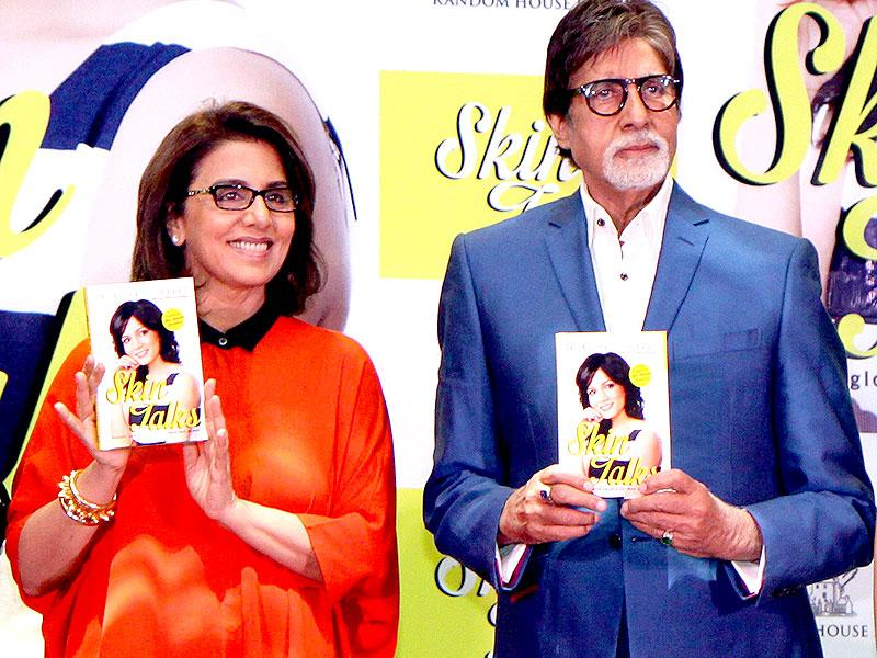 Actors Neetu Singh (left) and Amitabh Bachchan pose for a photograph during a promotional event in Mumbai on late October 5, 2014. (AFP)