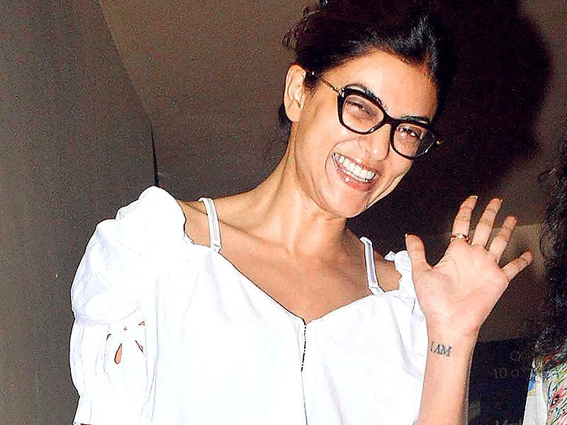 Sushmita Sen looks quite happy as she comes out of a movie screening. (Photos: Yogen Shah)