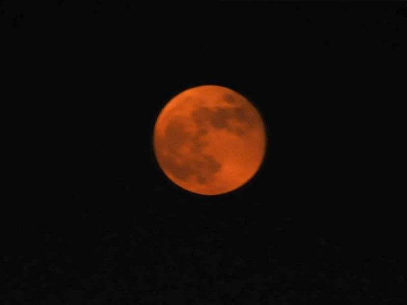The moon on Bhopal sky looked distinctly red when it rose on Wednesday evening, just after the lunar eclipse was over. (Mujeeb Faruqui/HT Photo)