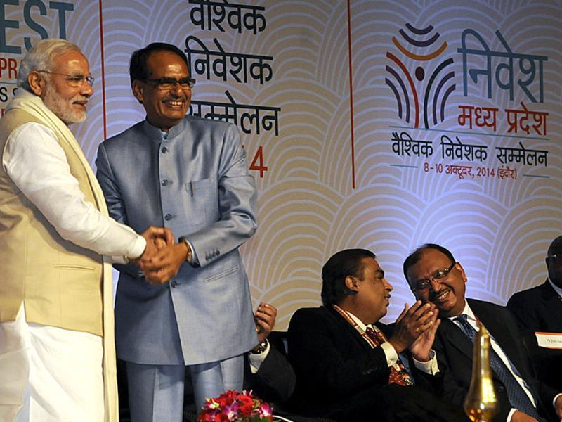 CM Shivraj Singh Chouhan greets PM Narendra Modi at the inaugural ceremony of Global Investors Summit in Indore. (Arun Mondhe/HT photo)