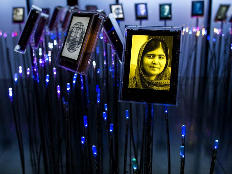 A portrait of Malala Yousafzai is seen in the Nobel's Garden in the Nobel Peace Center, after she was awarded a Nobel Peace Prize, in Oslo. (AP Photo)