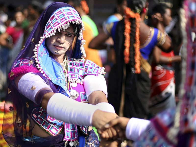 A member of Telangana Hijra Intersex Transgender Samiti (THITS), dressed in traditional clothing, performs during a protest in Hyderabad. (AP Photo)