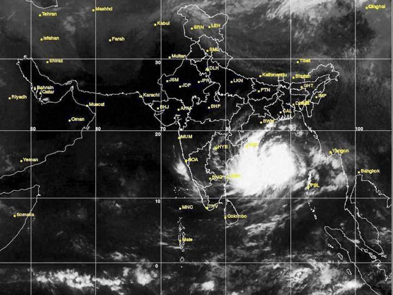 Cyclone Hudhud is expected to intensify in the next 24 hours, bringing heavy rain and gusting winds of about 100-110 km/hour as it inches closer to the coast of Andhra Pradesh and Odisha. (PTI Photo)