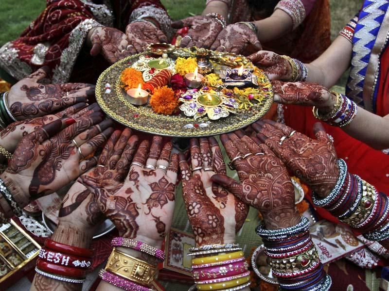 Married women celebrate Karva Chauth in Ahmedabad. (AP Photo)