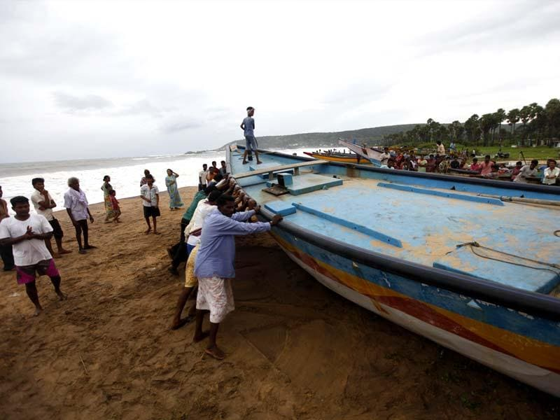 People are evacuated from Bheemili village as cyclone Hudhud is expected to hit the coast of Andhra Pradesh and Odisha on Sunday in Visakhapatnam. (Arun Sharma/HT Photo)