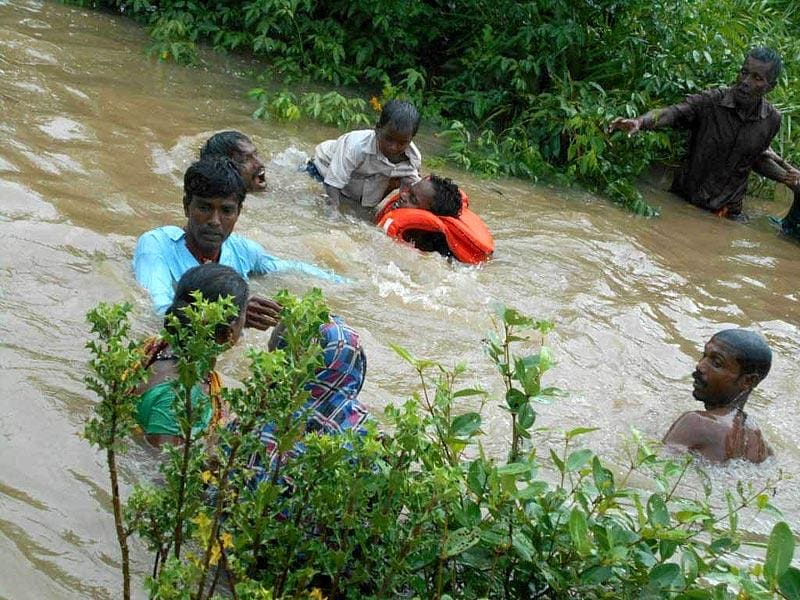 Residents of seaside village Satabhaya are rescued after their boat sank in Bausagali river in Odisha's Kendrapada district on Saturday. (Arabinda Mahapatra/ HT Photo)