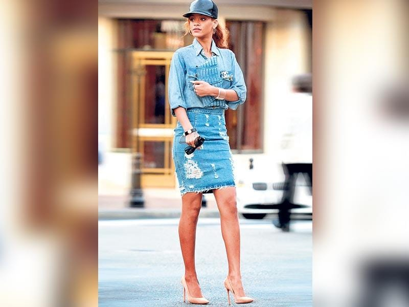 Rihanna's rocked denim on denim with a distressed pencil skirt, chambray shirt and a snake skin clutch | Double Trouble: Once a big no-no, mixing denim is now considered exciting due to the multitude of possibilities. The only secret to getting this trend right is balance— it's all about flattering your body type. Remember, lighter shades draw attention while darker ones give a slimming effect.