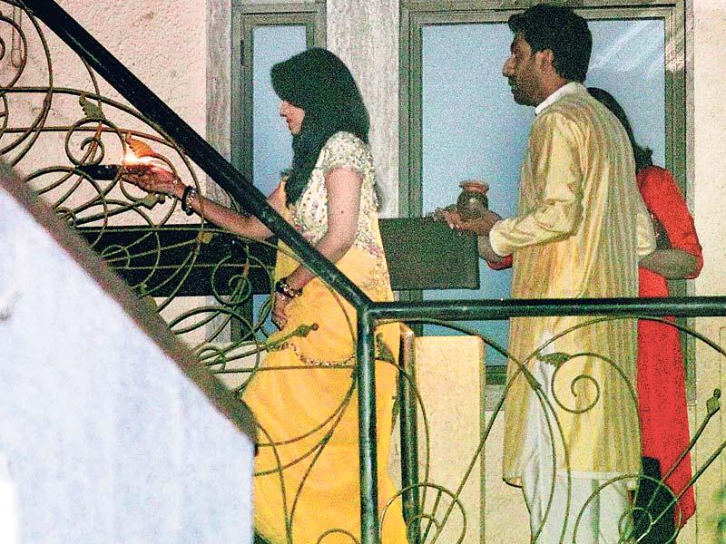 We spy Aishwarya and Abhishek Bachchan as they head to a terrace to see a full moon. (HT photo/Yogen Shah)