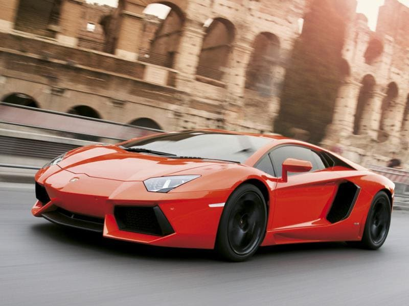 Lamborghini Aventador 0-60 mph in 2.9 seconds : Too long, too wide and too big to park yet incredibly fun to drive, the Aventador offers monstrous levels of power and draws a crowd of admirers wherever it goes. Photo:AFP