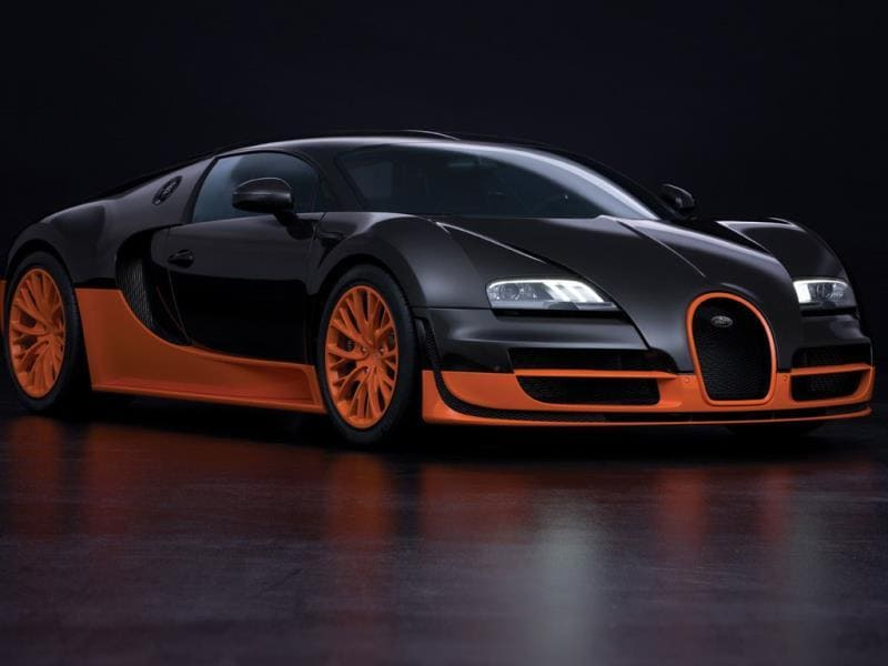 Bugatti Veyron 16.4 Super Sport 0-60 mph in 2.4 seconds : Not as fast as the Porsche but with one of the most technically complex petrol engines ever built – 16 cylinders in a 'W' formation, the Bugatti still boasts the highest top speed of any production car ever built – 267.8 mph. But what do you expect for over $1 million? Photo:AFP