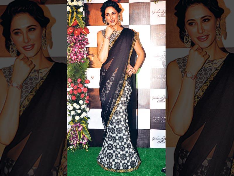 Nargis Fakhri was seen decked up in a gorgeous sari at a Mumbai event. (Photo: Viral Bhayani)
