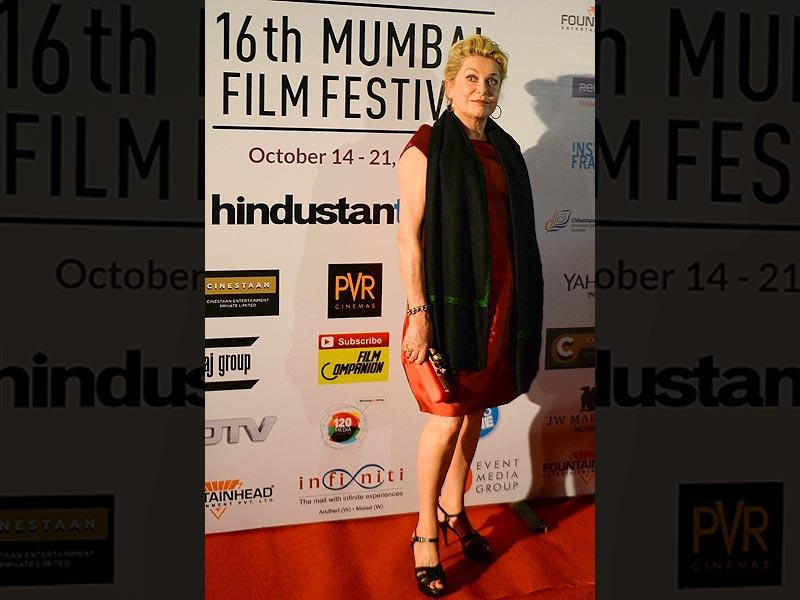 French actor Catherine Deneuve poses for photos at the opening ceremony of the 16th Mumbai Film Festival in Mumbai, India on October 14, 2014. The actor will receive the lifetime achievement award. (AP)