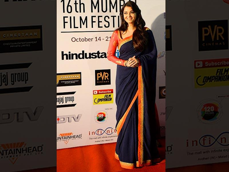 Actor Aishwarya Rai Bachchan poses for a photograph after arriving for the opening ceremony of the 16th Mumbai Film Festival in Mumbai on October 14, 2014. (AFP)