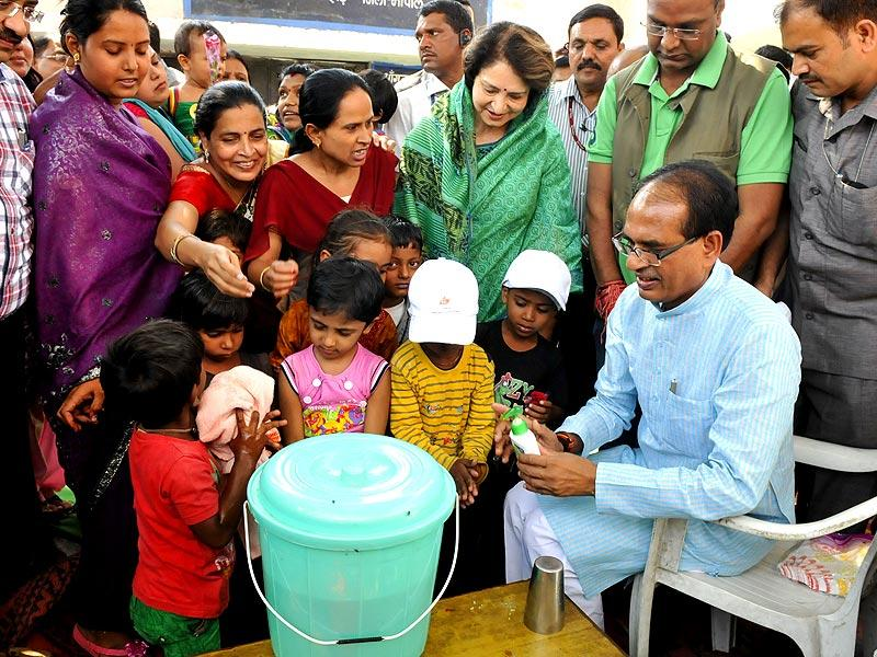 Madhya Pradesh CM Shivraj Singh Chouhan takes part in Global Hand Washing Day programme at an anganwadi centre in Bhopal on Wednesday. (Mujeeb Faruqui/ HT photo)