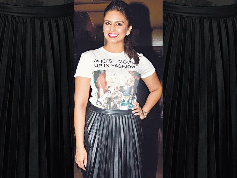With pleats in vogue, Huma Qureshi opts for a leather-like pleated skirt. She keeps her look casual by pairing it with a printed tee.