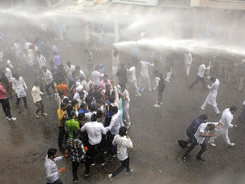 Police used water canons to disperse NSUI activists at Collectorate, in Indore on Friday. They were protesting against MP Professional Examination Board scam. (Arun Mondhe/HT photo)
